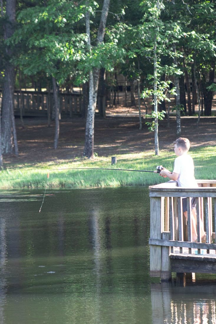 Family Fun at Little Black Creek Campground and Park fishing pier near cabins