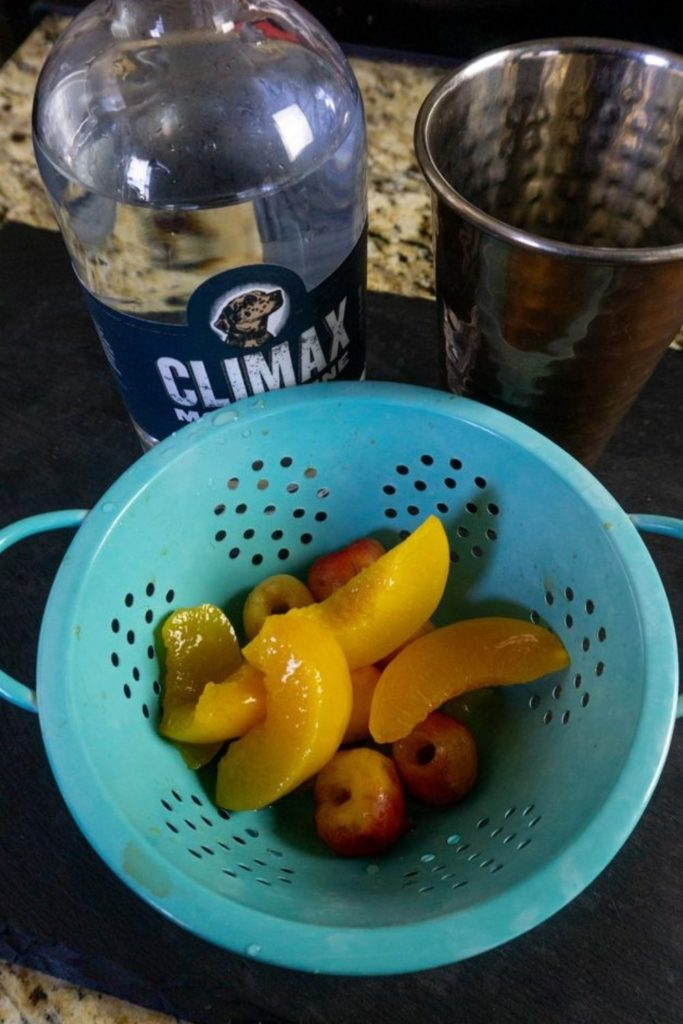 Peach and Rainier Cherries in a colander