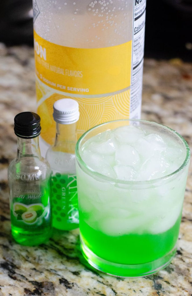 process image of glass and ice with green liquor